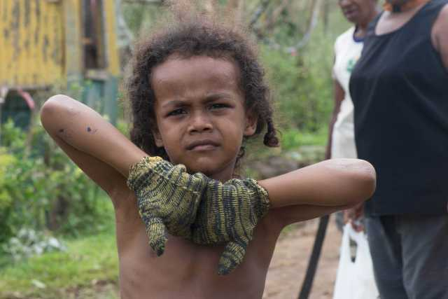 a-child-helps-with-the-clean-up-after-cyclone-pam-data